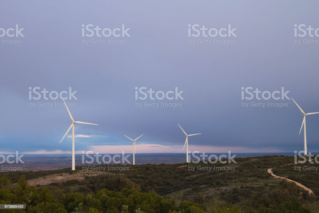 stormy landscape with windmills stock photo