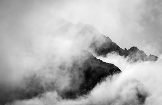 Stormy mountain silhouette background