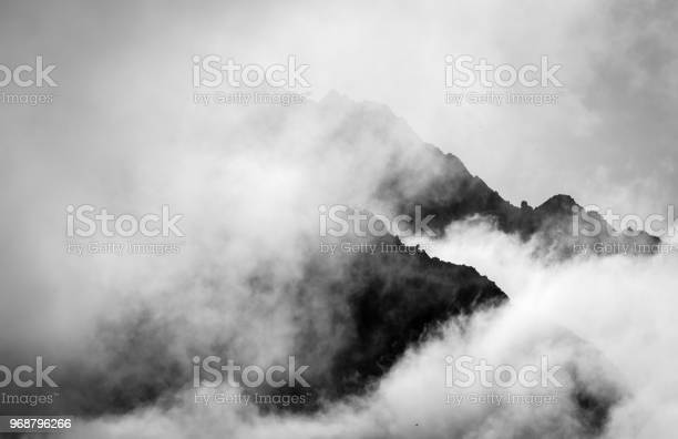Photo of Stormy mountain silhouette background