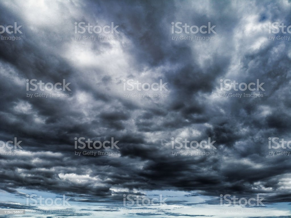 A moody sky with rising, dark storm clouds. Here we see only sky with...