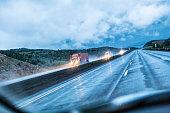 Stormy Rain Expressway Speeding Trailer Trucks