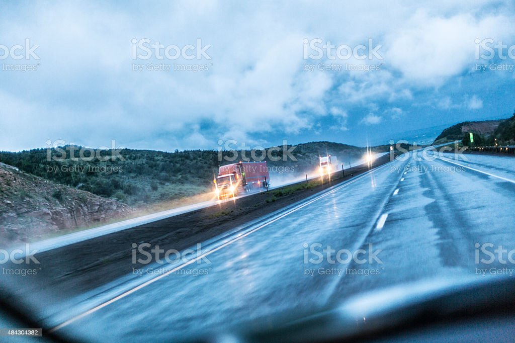 Stormy Rain Expressway Speeding Trailer Trucks stock photo