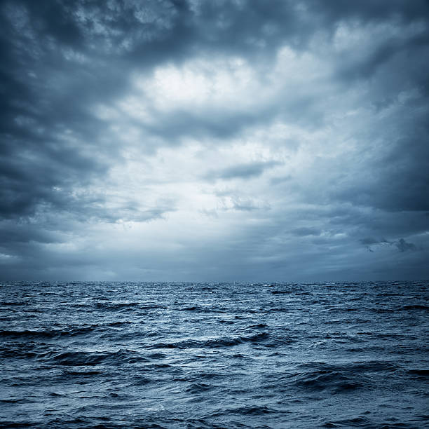 Stormy Sea and Sky. Dark Dramatic Background. Stormy Sea and Sky. Thundery Clouds and Gray Ocean. Wild Nature Dark Dramatic Background. Toned and Filtered Square Photo with Copy Space. desaturated stock pictures, royalty-free photos & images