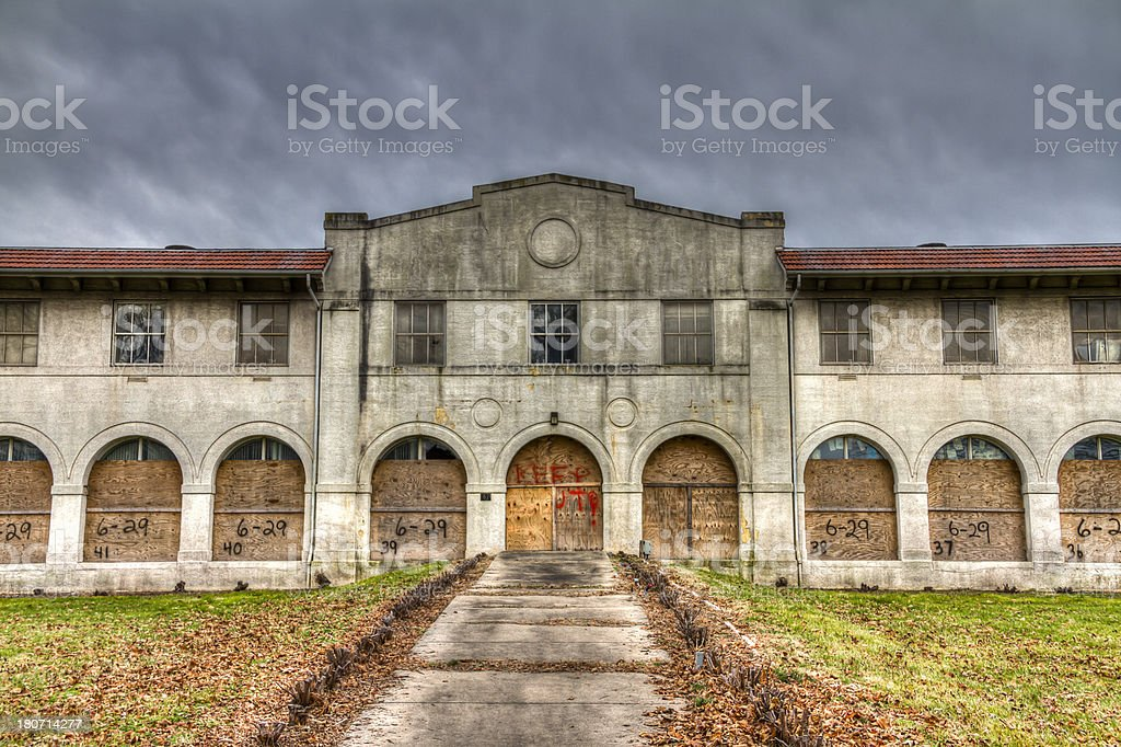 Stormy Skies Above an Abandoned and Boarded Up Medical Center stock photo