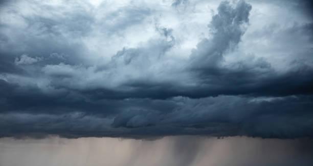 Stormy sky and rain.  apocalypse like Stormy sky and rain.  apocalypse like atmospheric mood stock pictures, royalty-free photos & images