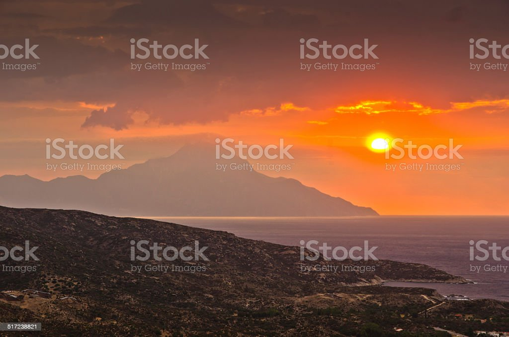 Stormy sky and sunrise at holy mountain Athos stock photo