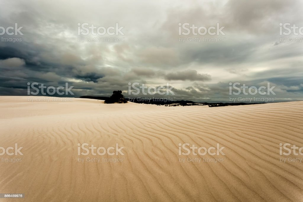 Stormy sky over a sand dune stock photo
