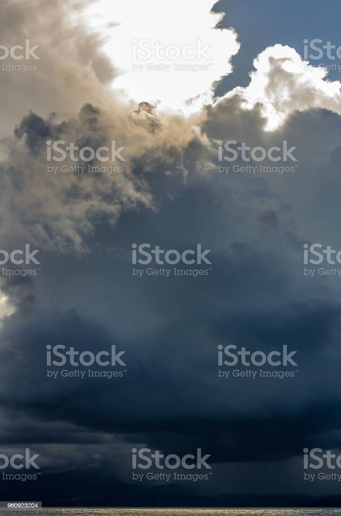 Stormy sky over Base-Terre island, Guadeloupe, with a gold glittering ocean stock photo
