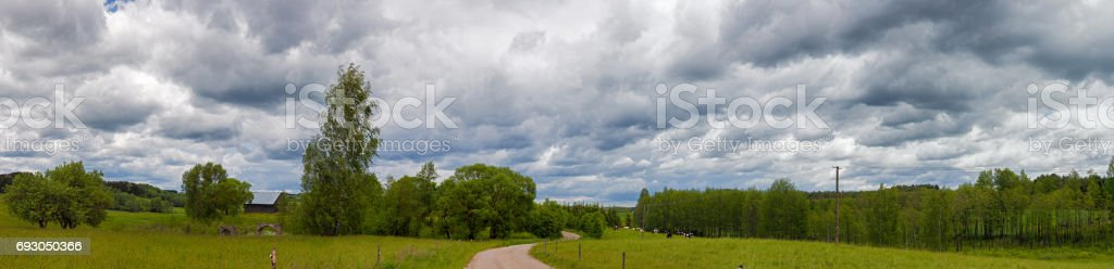 Stormy sky over meadow and rural road, HDR image, Poland, Europe stock photo