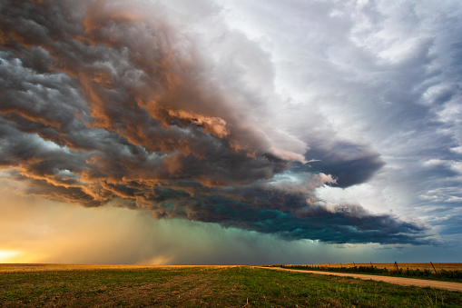 Stormy sky with dramatic clouds at sunset as a thunderstorm approaches.