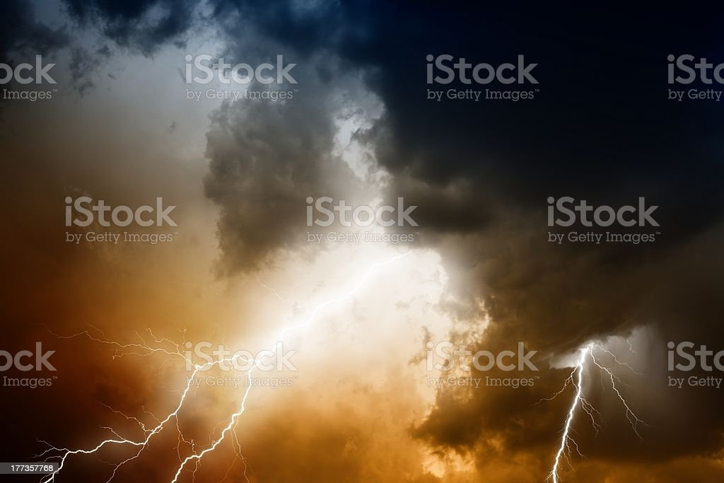 Stormy sky with lightning and sun light shining through royalty-free stock photo