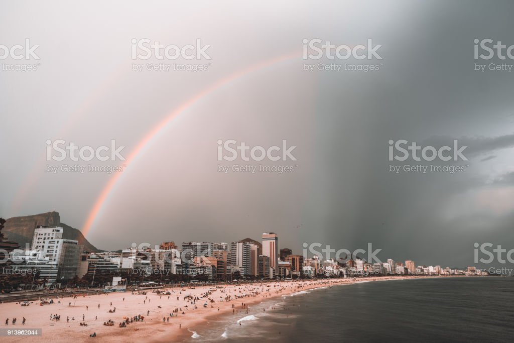 Stormy sky with rainbow over beach in Rio de Janeiro stock photo