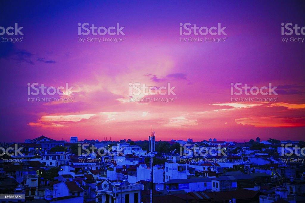 Stormy sunset over blue Hanoi houses royalty-free stock photo
