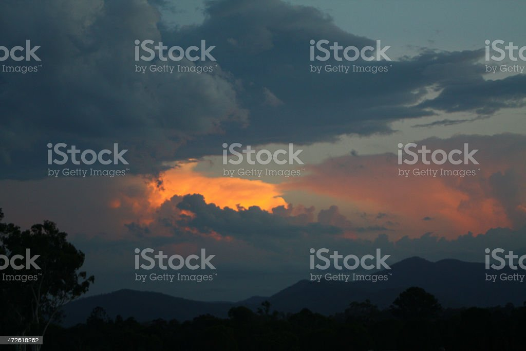 Stormy Sunset with a Reflection of Light on a Cloud stock photo