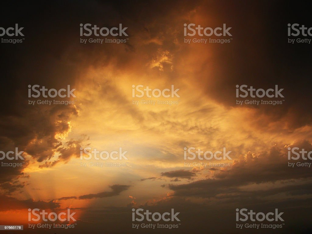 Stormy sunset with clouds and sun stock photo