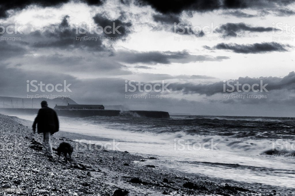 Stormy walk to the Cobb royalty-free stock photo