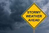 Stormy Weather Ahead Caution Sign With Storm Cloud Background