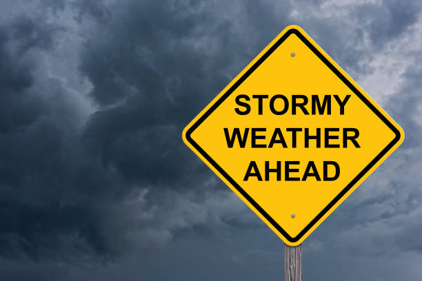 Stormy Weather Ahead Warning Sign Stormy Weather Ahead Caution Sign With Storm Cloud Background extreme weather stock pictures, royalty-free photos & images