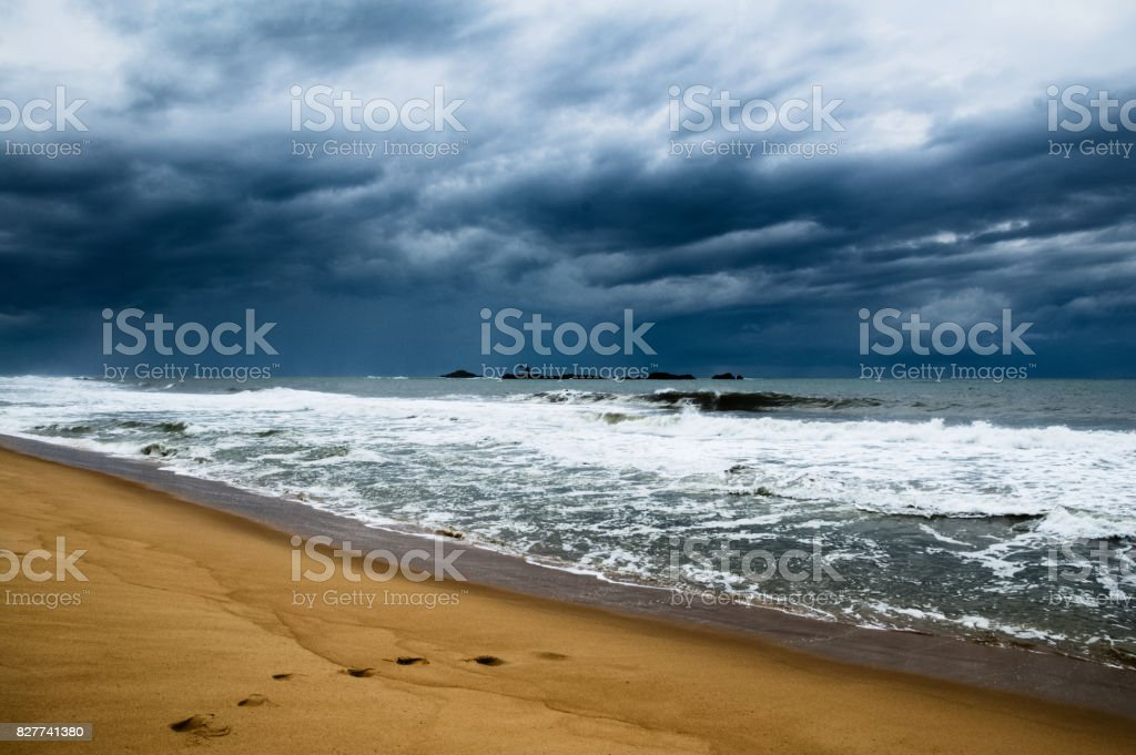 Stormy weather with dramatic clouds at an empty beach in Madagascar stock photo