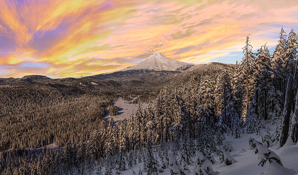 Stormy Winter Vista of Mount Hood in Oregon, USA. Majestic View of Mt. Hood on a stormy evening during the Winter months. mt hood stock pictures, royalty-free photos & images