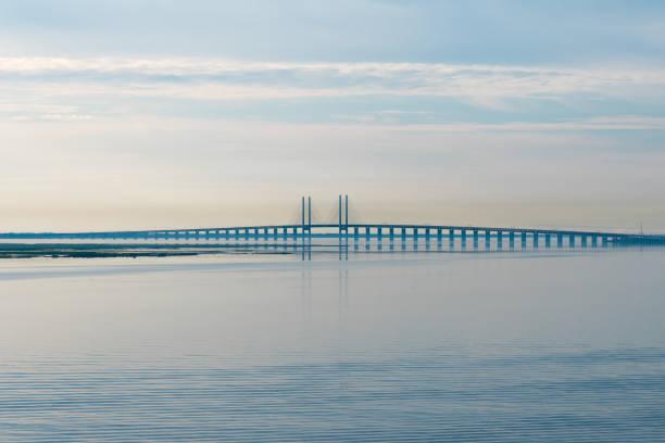storstrømsbroen bridge under sunrise - öresund bildbanksfoton och bilder