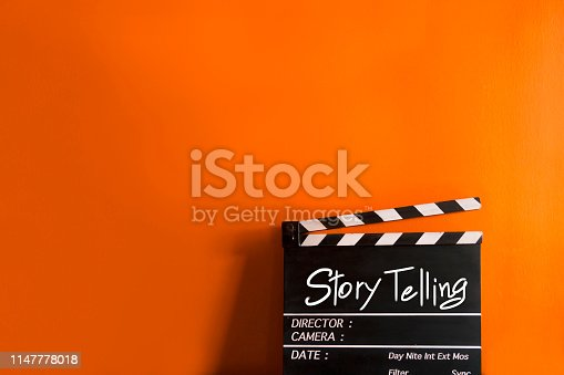 istock Story telling text title on film slate for movies and digital marketing 1147778018