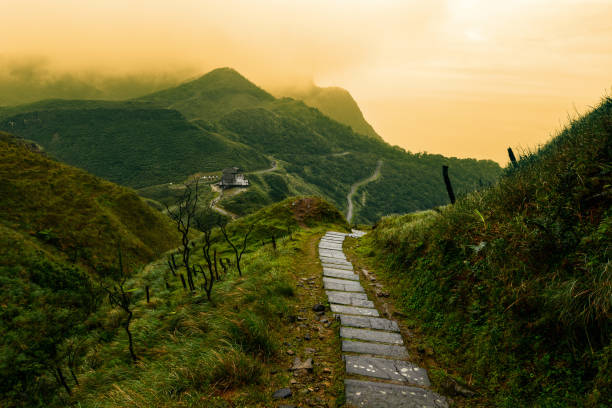 Storybook-like pathway through a misty mountain landscape in Taiwan's Yilan County stock photo
