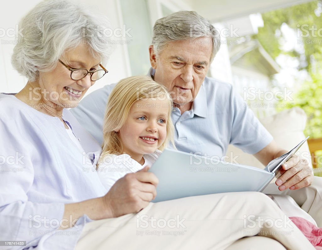 Storytime with grandpa and granny! royalty-free stock photo