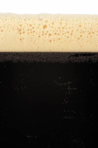 stout beer - dark beer stock photos and pictures