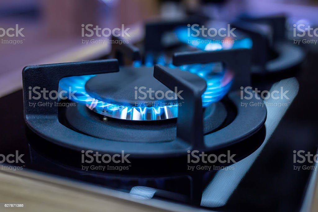 Stove. Cook stove. Modern kitchen stove with blue flames burning stock photo