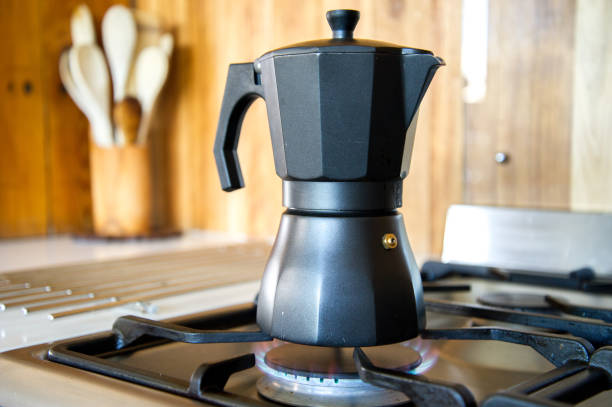 Stove Top Coffee Percolator Gas Stove Top Coffee Percolator In A Kitchen coffee pot stock pictures, royalty-free photos & images