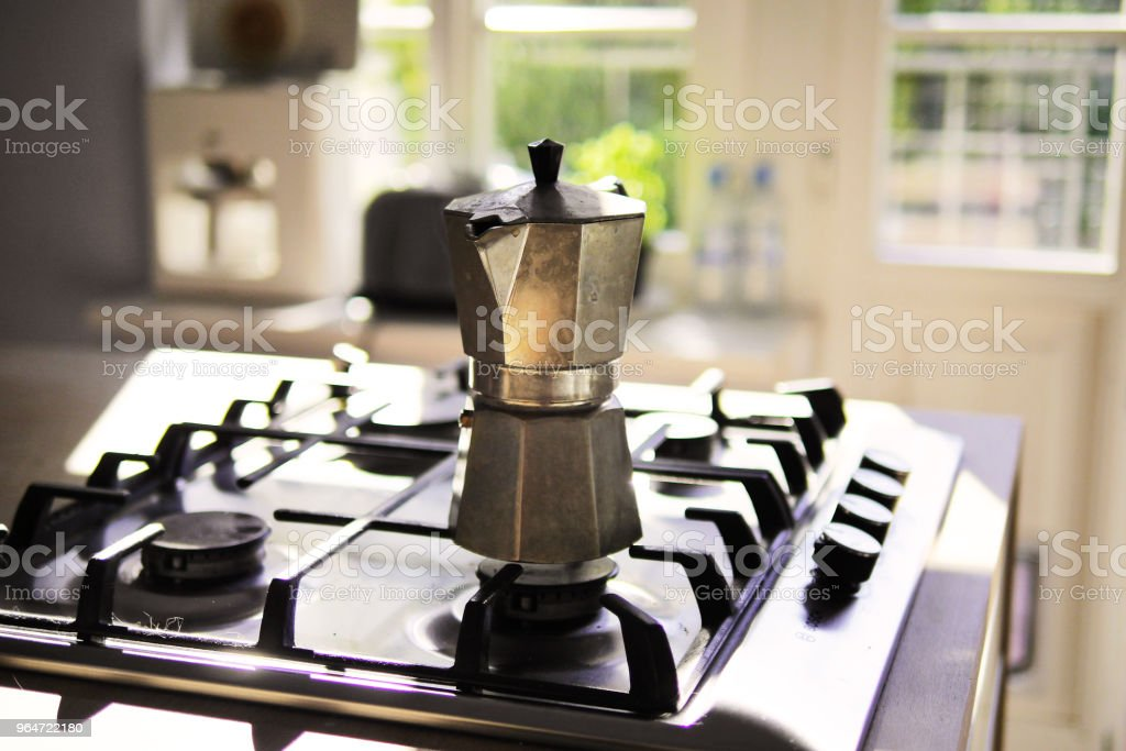 Stovetop Espresso Maker in Sunlit Kitchen royalty-free stock photo