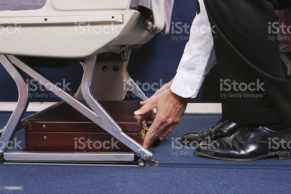 Stowing A Briefcase stock photo