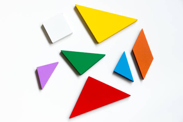 Straggled tangram puzzle  wait to complete the shape on white background stock photo