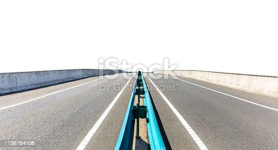 621693226istockphoto Straight asphalt road on white background 1136784108
