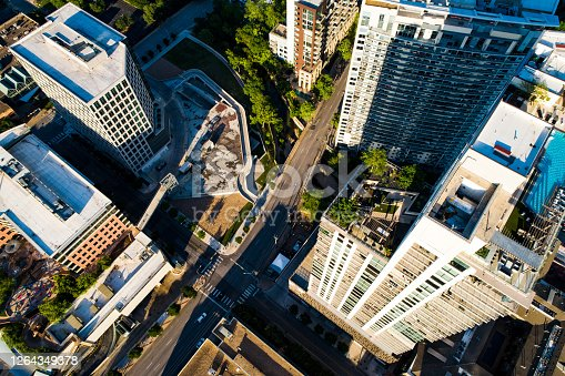 Drone top down view above Urban Austin Infrustructure , streets , bridges and downtown urban cityscape