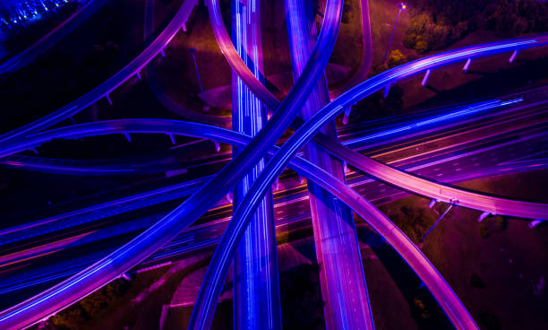 Straight down drone angle above transportation highways infrastructure and travel time in a ultraviolet finish Straight down drone angle above transportation highways infrastructure and travel time in a ultraviolet finish overpass road stock pictures, royalty-free photos & images