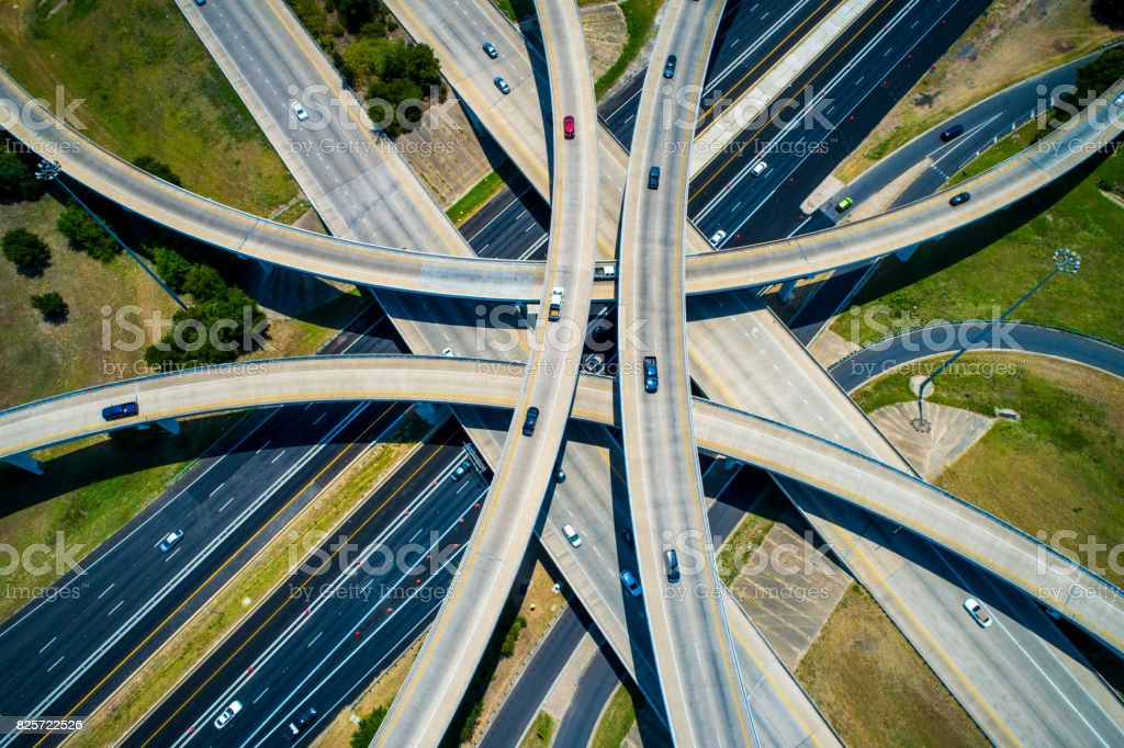 straight down drone view high above abstract Curved highways and Interchanges and Overpasses aerial drone high above stock photo