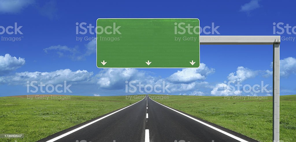 Straight Highway with Blank Roadsign bildbanksfoto