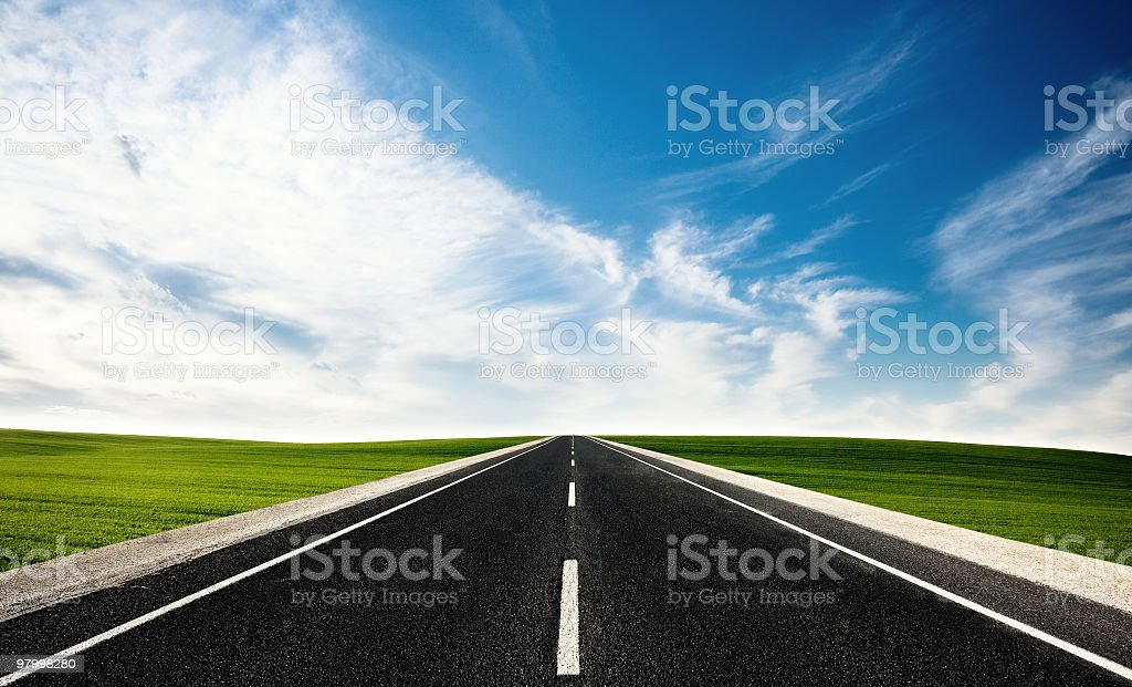 Straight highway with grass on each side  royalty-free stock photo