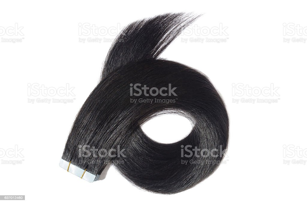 Straight jet balck adhesive tape in human hair extensions - foto de acervo