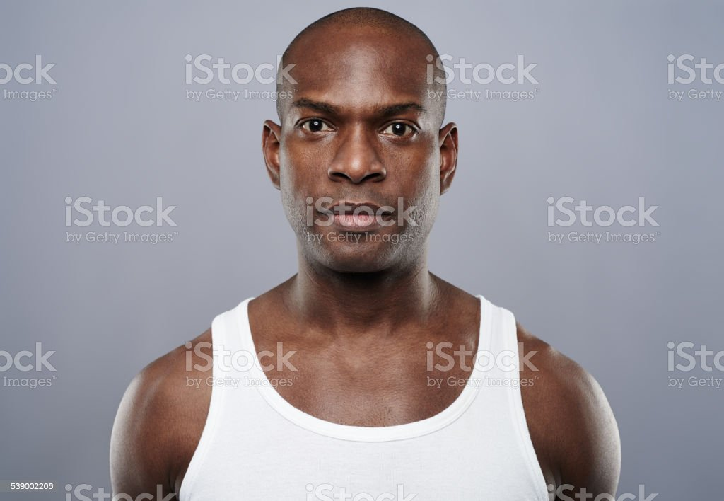 Straight on view of handsome man in undershirt stock photo
