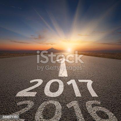 istock Straight open road to upcoming 2017 at idyllic sunset 533571382