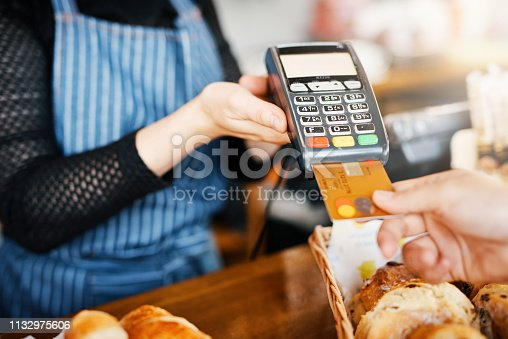 Cropped shot of an unrecognizable man paying for his purchase by card