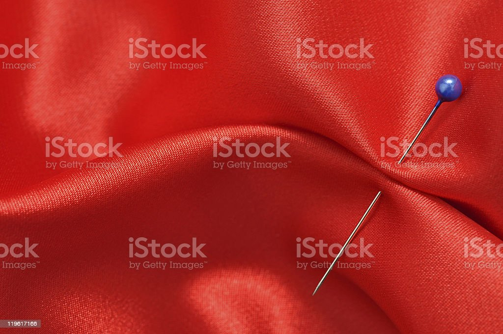 Straight Pin in Red Silk royalty-free stock photo