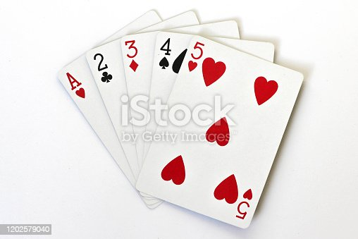 istock A straight poker hand with playing cards, different suits 1202579040