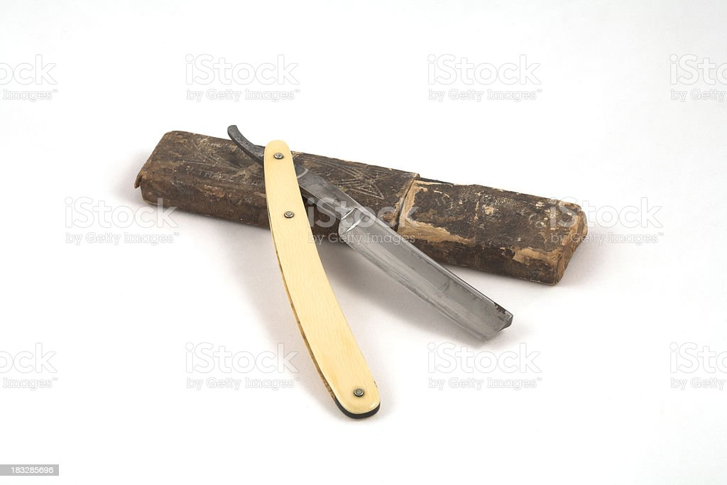 Straight Razor With Bone Handle On an Old Leather Case royalty-free stock photo