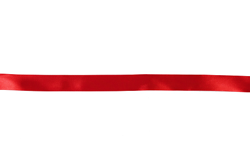 straight red ribbon separates white background. High quality photo