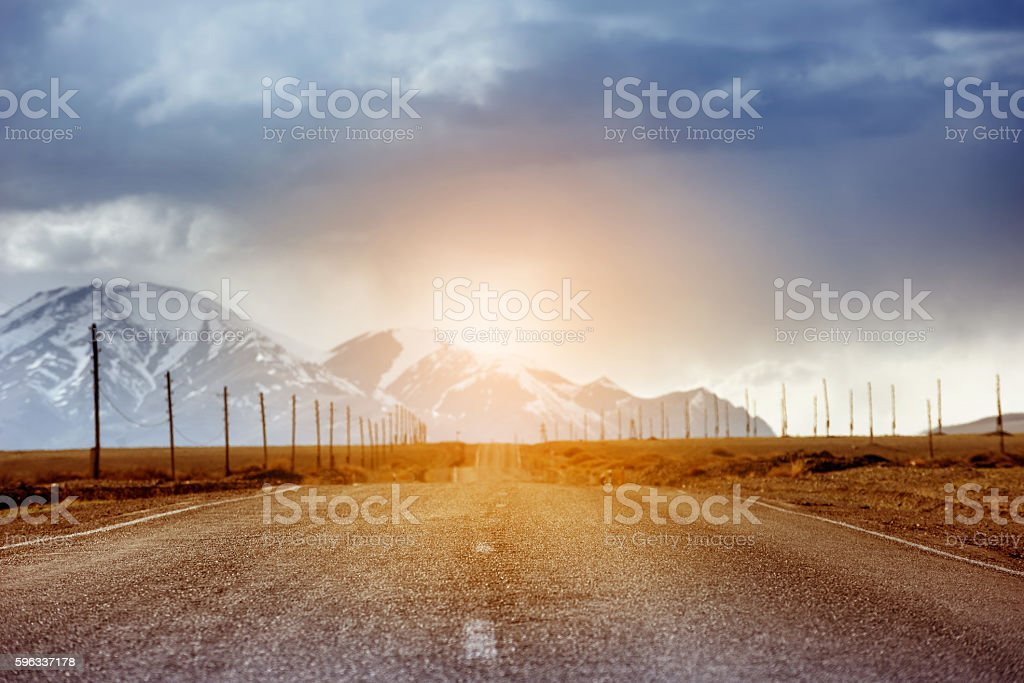 Straight road car concept. Mountains backdrop royalty-free stock photo