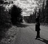 Straight Road, curvy woman.
